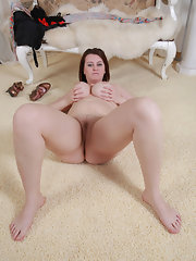 Chubby older babe takes off red nylons and shows ass and pussy
